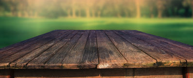 Old wood table in field Royalty Free Stock Photography