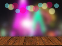 Old  wood table top on colorful blurred light abstract backgroun Stock Image