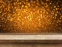 Old wood table top on copper gold glitter bokeh Stock Photography