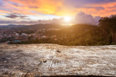 Old wood table top with sunlight and blur background Stock Image