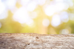 Old wood table top with sunlight bokeh and blur background Royalty Free Stock Photography