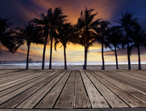 Old wood terrace on sea beach with coconuts tree and beautiful d Stock Image