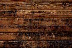 Old wood texture background. Dark brown wooden boards, planks. Surface of dark shabby weathered parquet, desk. Vintage pattern of. Rustic oak, table. Woody stock photos