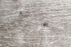 Old wood texture background, structure of a natural untreated wooden surface with peeling fibers and cracks Stock Images