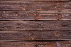 Old wood texture with knot. The brown old wood texture with knot Stock Image