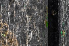 The old wood texture with natural patterns and cracks on the surface as background. Darken from center. Royalty Free Stock Images