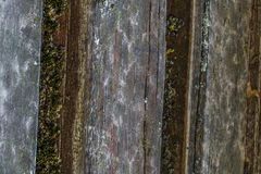The old wood texture with natural patterns and cracks on the surface as background. Darken from center. Royalty Free Stock Photos