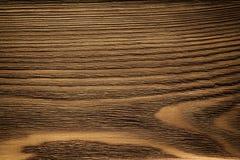 Wooden plank, dark brown board, vintage background stock photography
