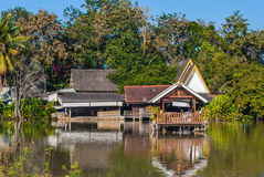 Old Wood Thai Style Pavilion Built on Lake Stock Image