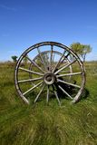 Old wood wagon wheels. Old wagon wheel with wood hub and spokes located in a meadow Stock Photography