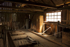 Old wood warehouse. This place was used to store wood, now is is empty and abandoned Royalty Free Stock Photos