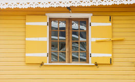 Old Wood Window in Bright Yellow Wall Stock Photos