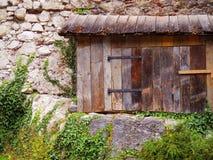 Old wood window on stone wall architect, climbing plant vintage Stock Photos