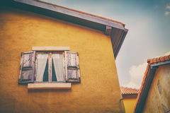 Old wood window on yellow wall Royalty Free Stock Photo