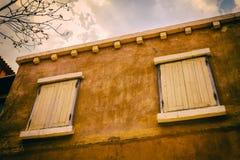 Old wood window on yellow wall Stock Image