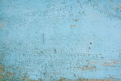 Old woodan wall, shabby paint as background. Wood texture with painting color peeled off. Flaking paint - wood background texture Stock Photography