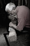 Woodcarver working with mallet and chiesel Royalty Free Stock Photography