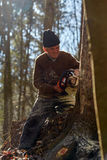 Old woodcutter at work with chainsaw Royalty Free Stock Photo