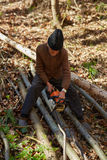 Old woodcutter at work with chainsaw Stock Photography