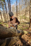 Old woodcutter at work with chainsaw Royalty Free Stock Images