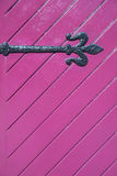 Old woodden ferrule. Old woodden pink door with ferrule background Royalty Free Stock Photography