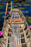 Old wooded boat on blossom lotus field or garden Beautyful Royalty Free Stock Photography