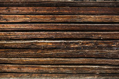Old wooded wall. Fragment of old wooded wall from logs, background Royalty Free Stock Photo