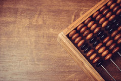 Old wooden abacus. On wooden background Stock Photography