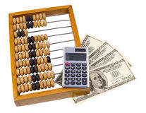 Old wooden abacus, calculator and U.S. dollars Stock Photos