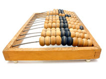 Old wooden abacus close up. Accounting abacus for financial calculations lies on a white background Stock Photo