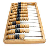 Old wooden abacus close up. Accounting abacus for financial calculations lies on a white background Stock Image
