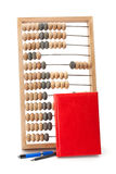 Old wooden abacus notebook and pen Stock Images