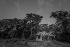 Old wooden abandoned cottage against sky Stock Photo