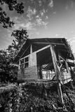 Old wooden abandoned cottage against sky Royalty Free Stock Photos
