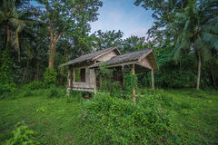 Old wooden abandoned cottage against sky Stock Images