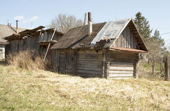 Old wooden abandoned house. Spring. Old abandoned wooden house with a pipe. Spring Stock Photos