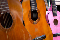 Old Wooden Acoustic Guitars on Antique Market Royalty Free Stock Images