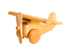 Old wooden airplane toy. Old wooden, hand made toy in the form of an airplane Stock Image