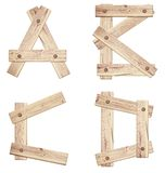 Old wooden alphabet letters made of wood planks Stock Image