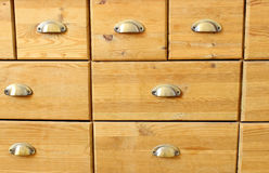 Old wooden antique chest of drawers with metal handles Stock Images