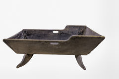 Old Wooden Antique Cradle. Cutout of old wood homemade antique cradle.n royalty free stock photography