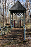 Old wooden arbour. Summerhouse in park. spring Royalty Free Stock Image
