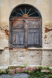 Old wooden arc window. The old wooden  arc window in a decayed wall Stock Image