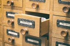 Old wooden archive files catalog drawer, Restricted files royalty free stock image