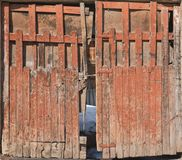 Old wooden back yard door, front view shot. Old wooden backyard door, front view shot composition Royalty Free Stock Photography