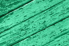 Old wooden background of boards with cracked and peeling paint stock photography