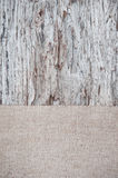 Old wooden background with burlap jute canvas Royalty Free Stock Photos