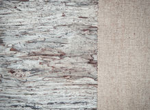Old wooden background with burlap jute canvas Stock Image