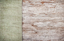 Old wooden background with burlap jute canvas Royalty Free Stock Photography