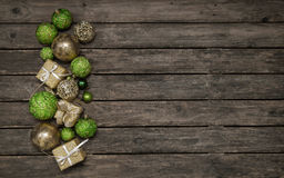 Old wooden background with christmas decoration in apple green a Royalty Free Stock Images